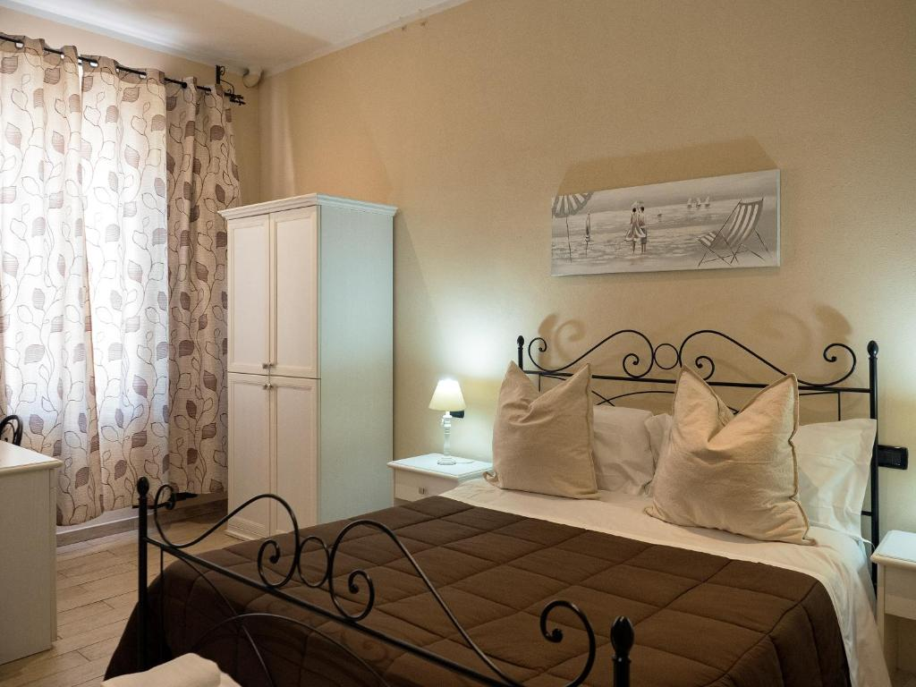A bed or beds in a room at Affittacamere Lunamar