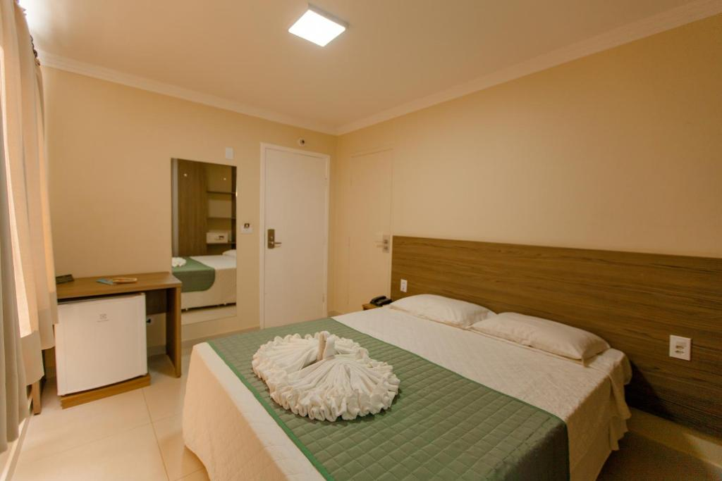 A bed or beds in a room at Cataratas Park Hotel
