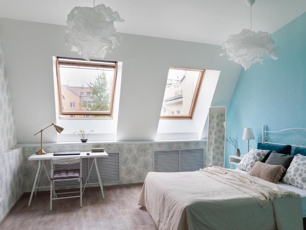 Letto o letti in una camera di Shaulis Apartment on Nevsky 117