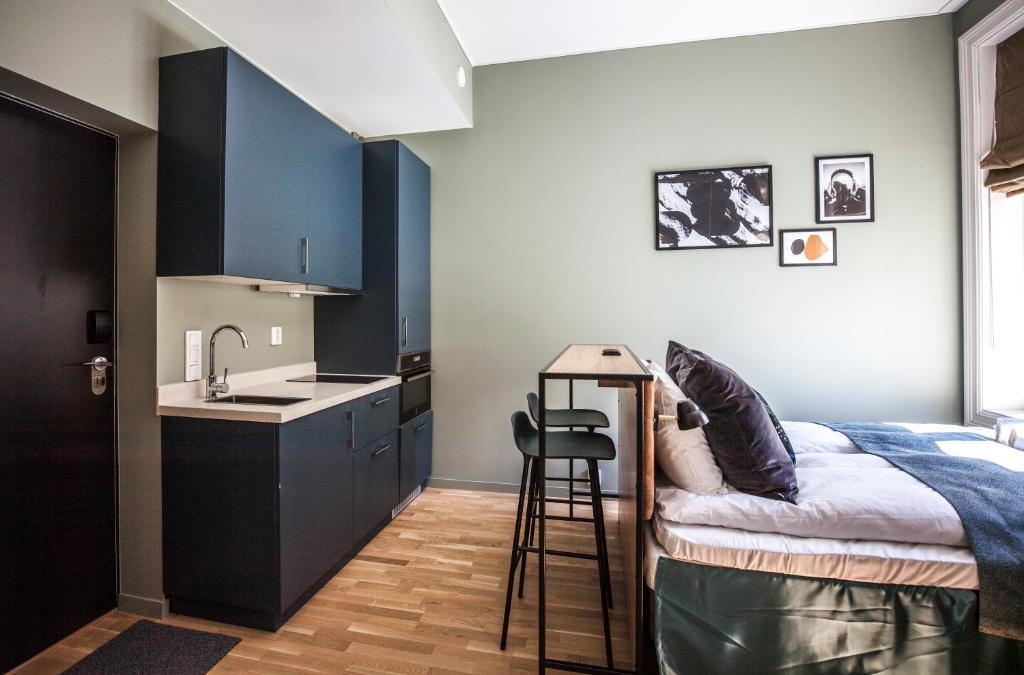 Virtuvė arba virtuvėlė apgyvendinimo įstaigoje Frogner House Apartments - Arbins gate 3