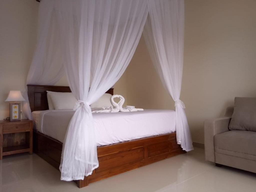 A bed or beds in a room at Nadya Homestay