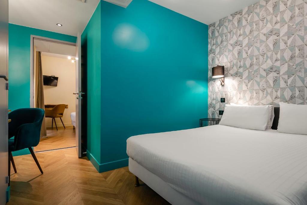 Кровать или кровати в номере Hotel Elysée Etoile
