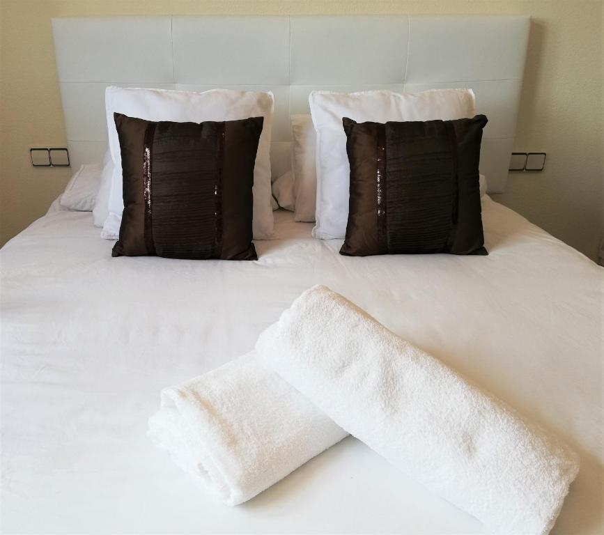 A bed or beds in a room at ATICO DUPLEX RETIRO PACIFICO