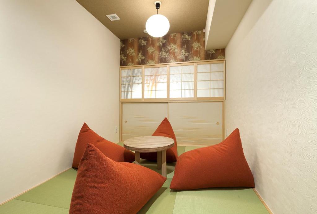 A seating area at Hundred Stay Tokyo Shinjuku
