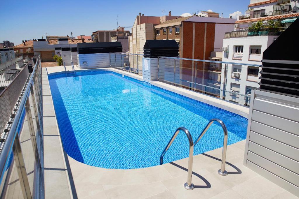 The swimming pool at or near Aparthotel Bcn Montjuic