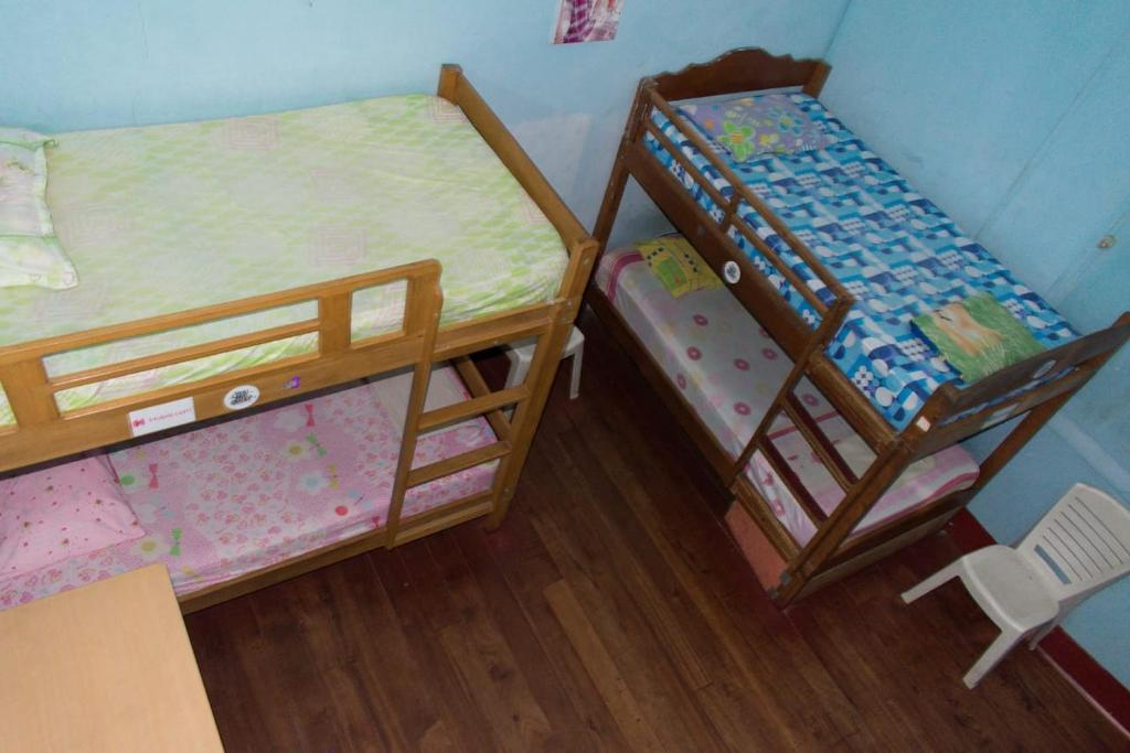 A bunk bed or bunk beds in a room at Mad Mick`s BunK House