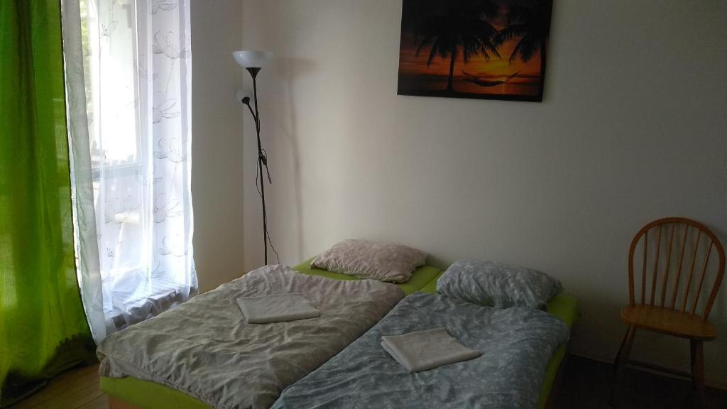 Кровать или кровати в номере Backintime