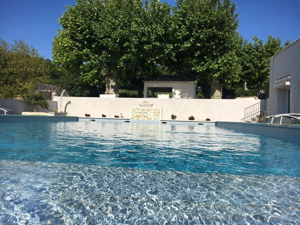 The swimming pool at or near DOMAINE FORVENT