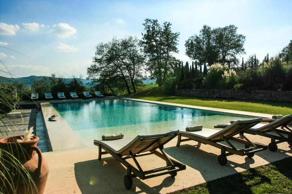 The swimming pool at or near Villa Rignana