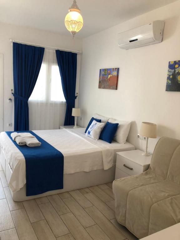 A bed or beds in a room at White and Blue Bodrum