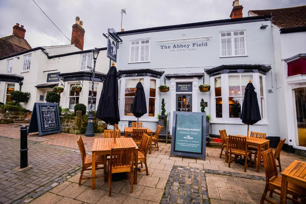 A restaurant or other place to eat at The Abbey Field By Greene King Inns