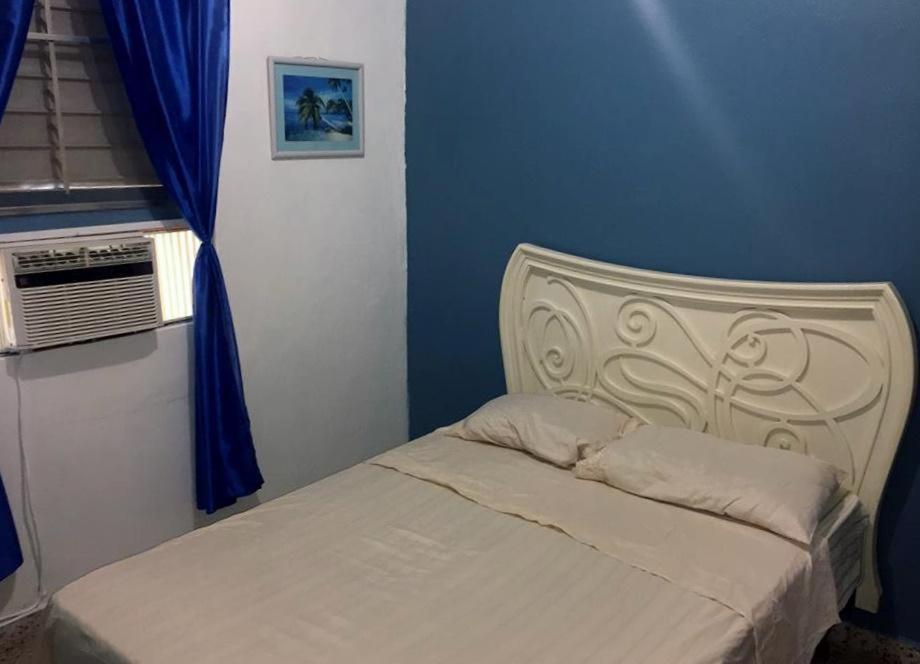 A bed or beds in a room at Brisas de Borinquen