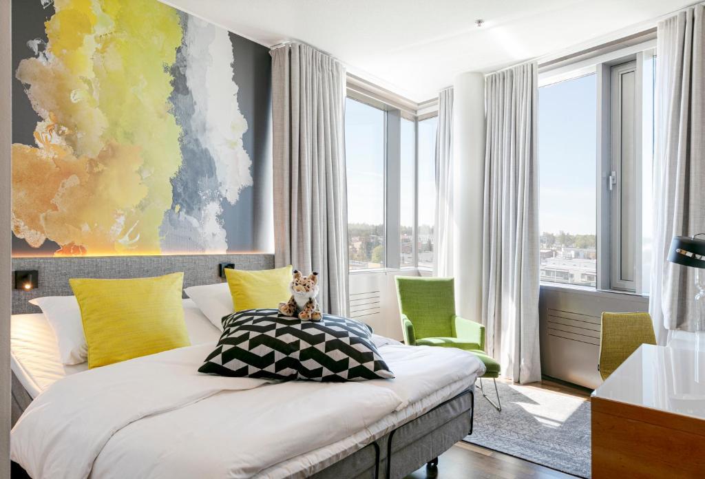 Säng eller sängar i ett rum på Glo Hotel Sello