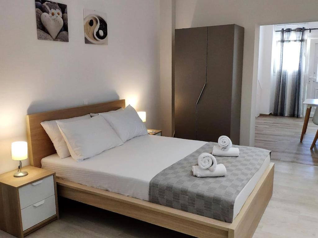 A bed or beds in a room at Brand New Studio by the Beach