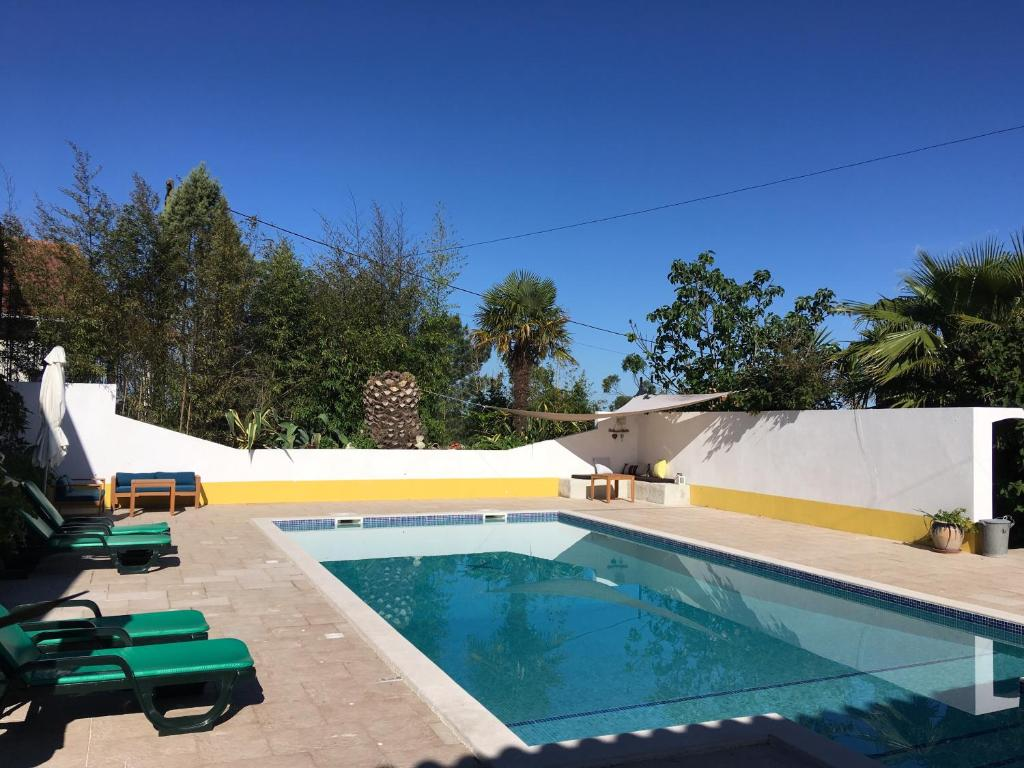 The swimming pool at or near Casa das Flores