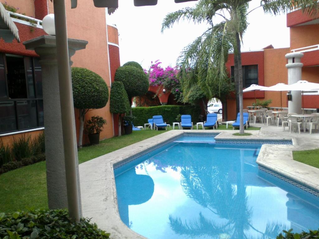 The swimming pool at or near Hotel Real del Sol
