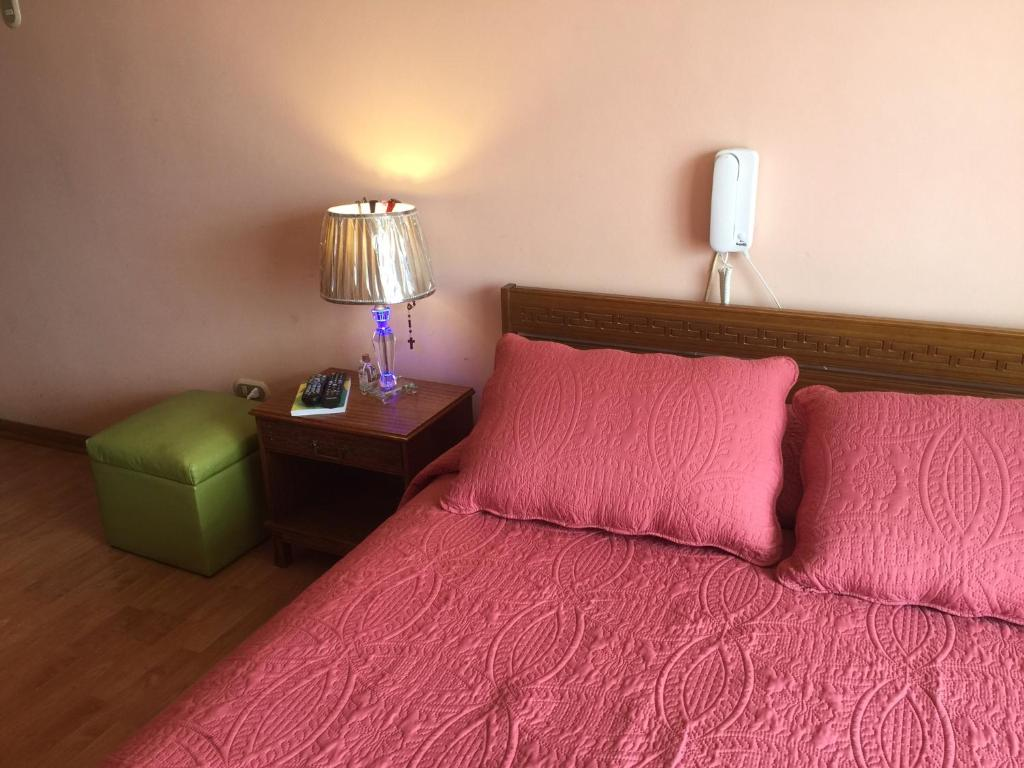 A bed or beds in a room at Casa Familiar Acogedora