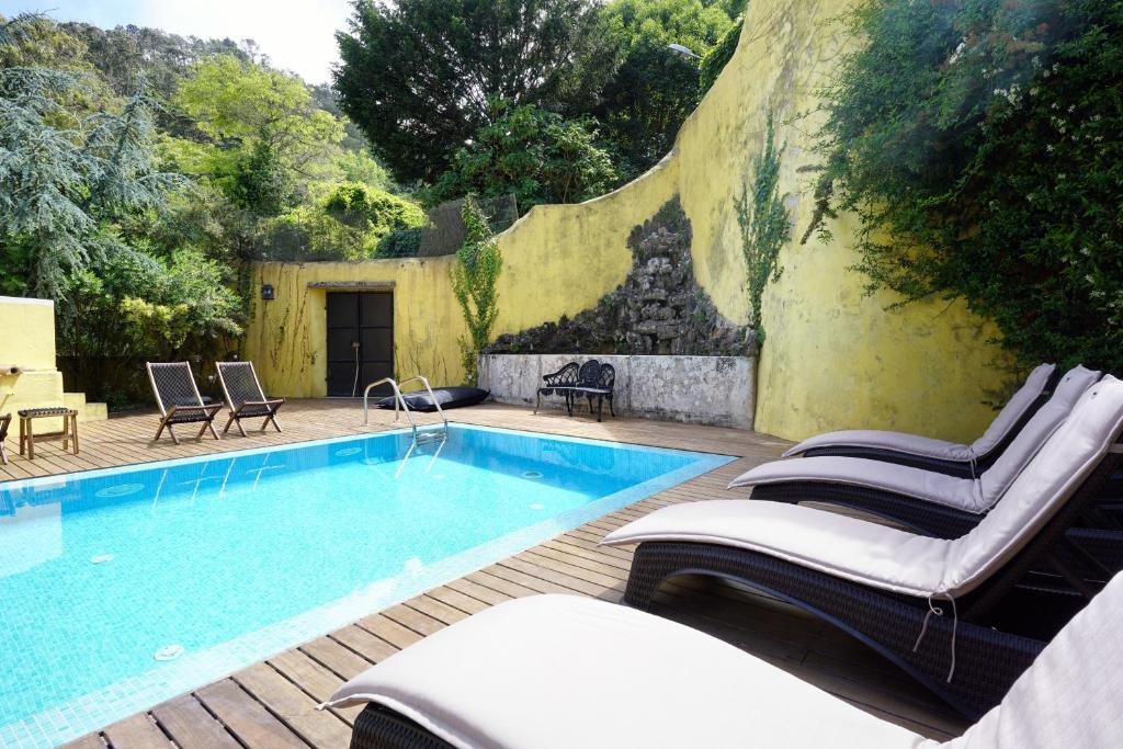 The swimming pool at or near Charm Inn Sintra