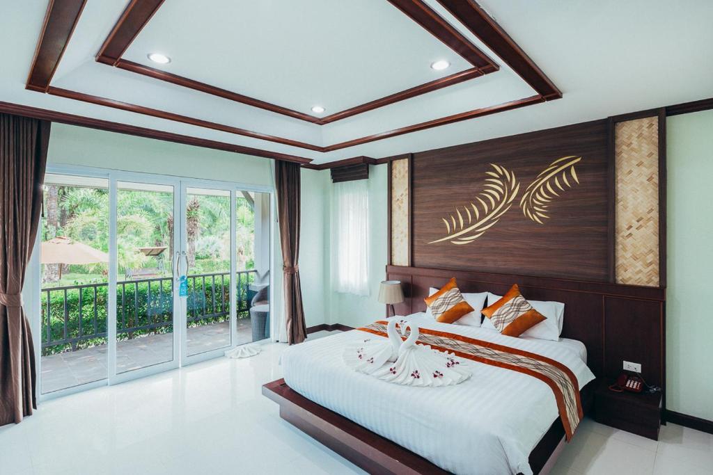 A bed or beds in a room at Palm Kiri Aonang Resort