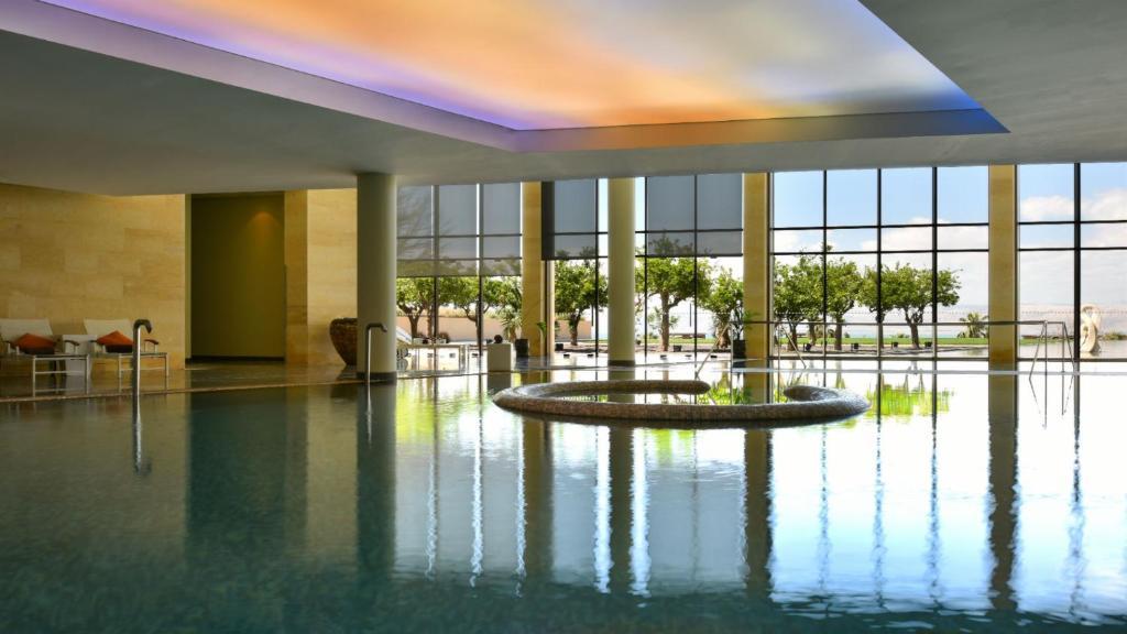 The swimming pool at or near Kempinski Hotel Ishtar Dead Sea