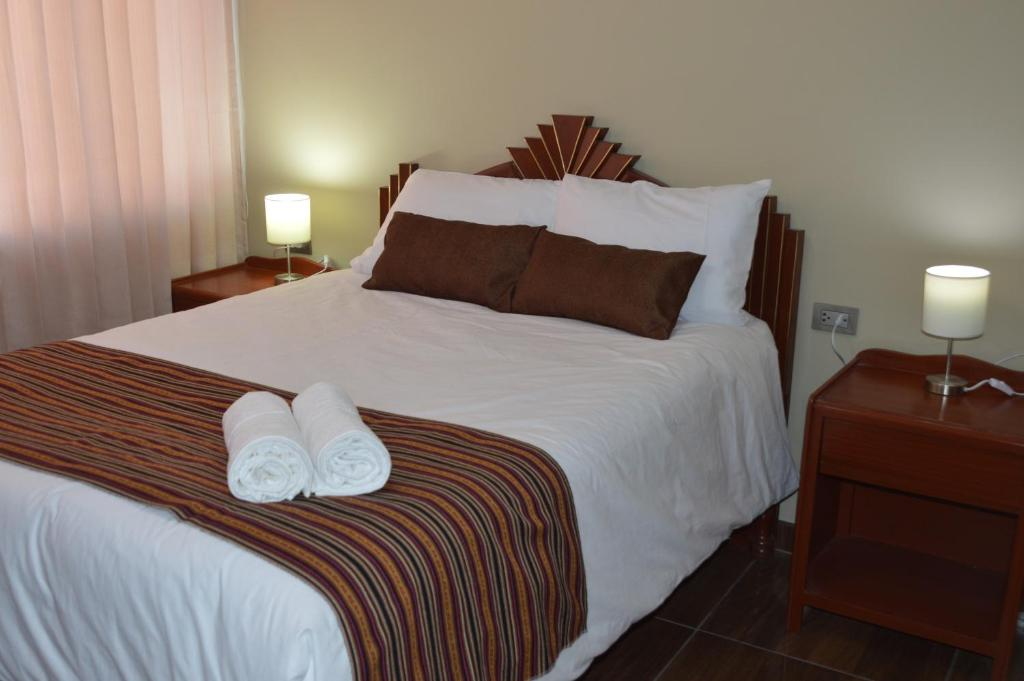 A bed or beds in a room at Mística Boutique Hotel