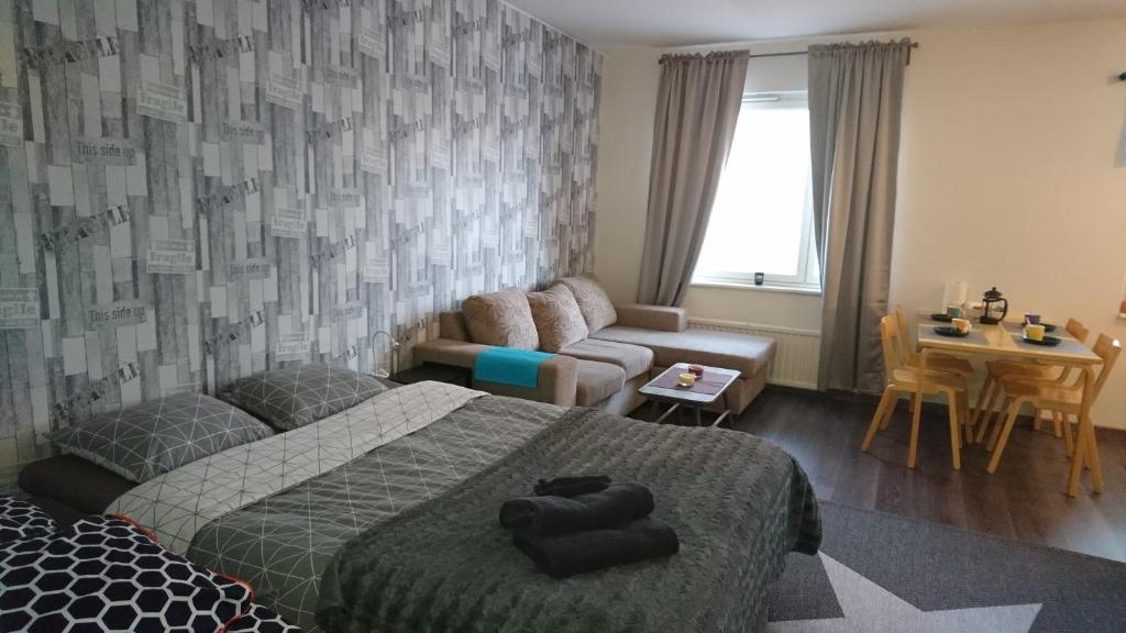 A bed or beds in a room at Vuoksi Apartment