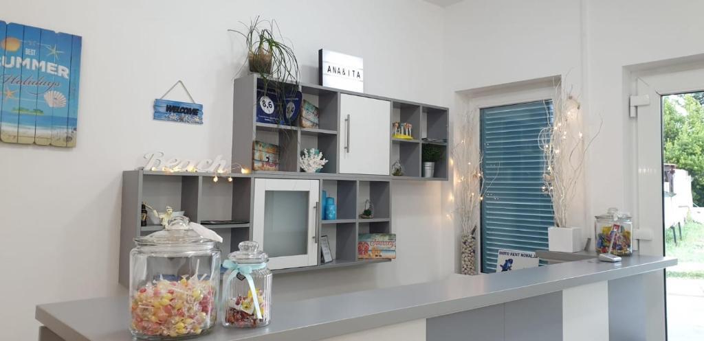 A kitchen or kitchenette at Apartments Ana&Ita