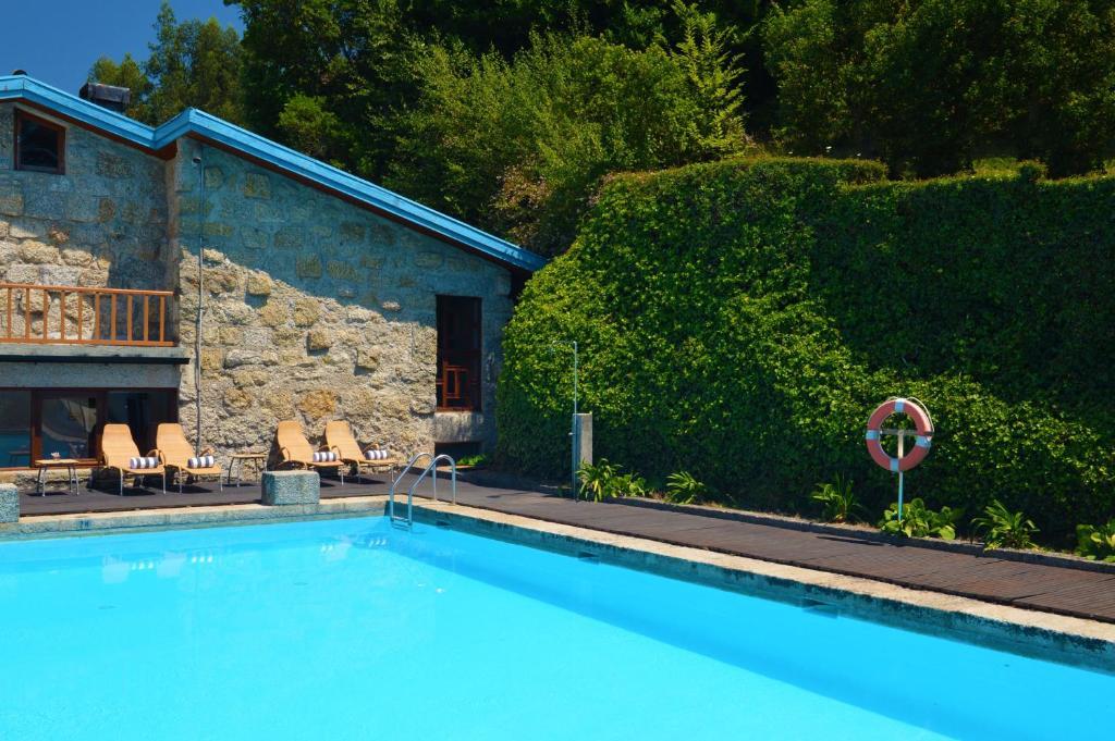 The swimming pool at or near Pousada Geres-Caniçada