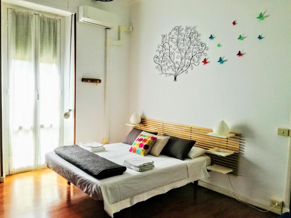 Uma cama ou camas num quarto em Amphora House