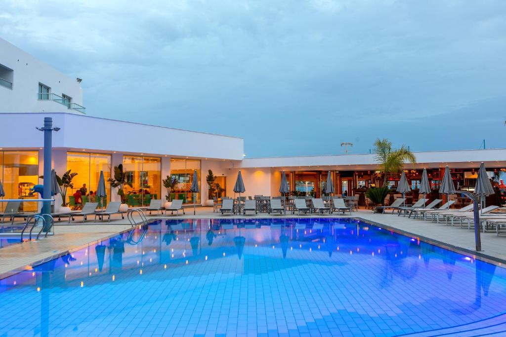 The swimming pool at or near Limanaki Beach Hotel
