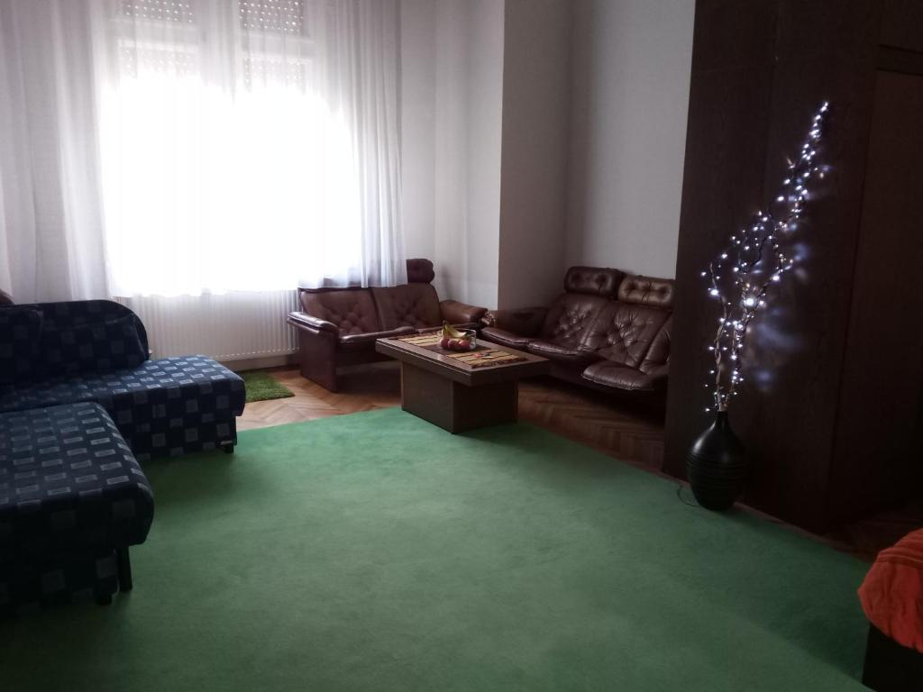 A seating area at Master apartment