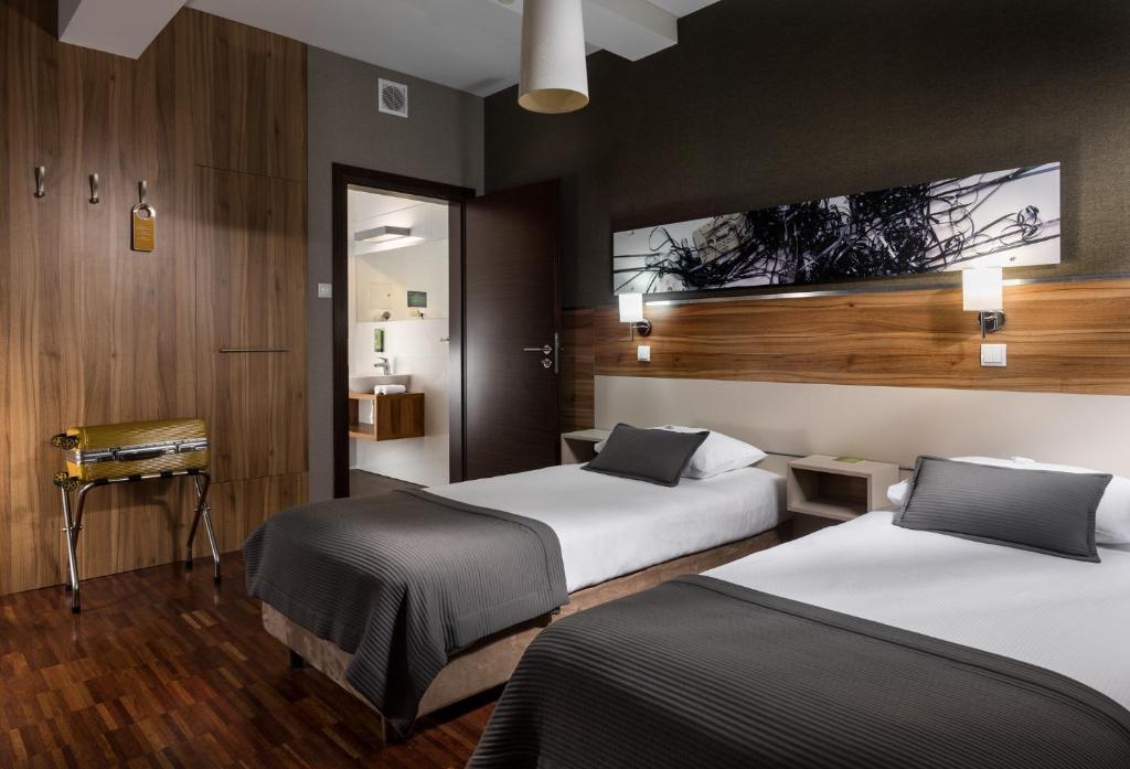 Vuode tai vuoteita majoituspaikassa Hotel Beethoven