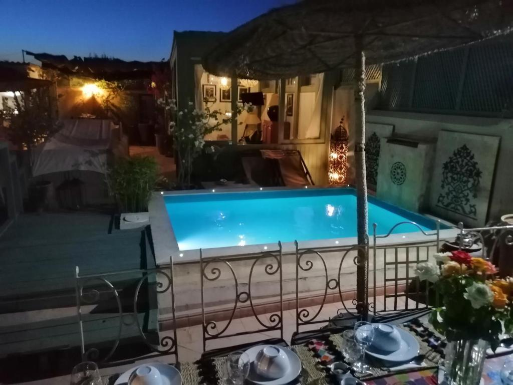 The swimming pool at or near Riad Swaka
