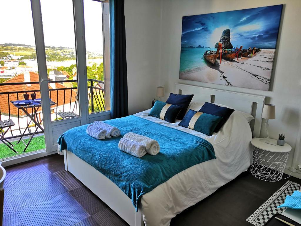 Un ou plusieurs lits dans un hébergement de l'établissement Studio Gambetta