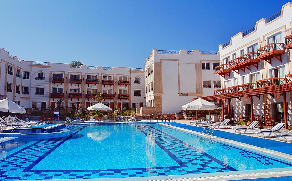 The swimming pool at or near Falcon Naama Star Hotel