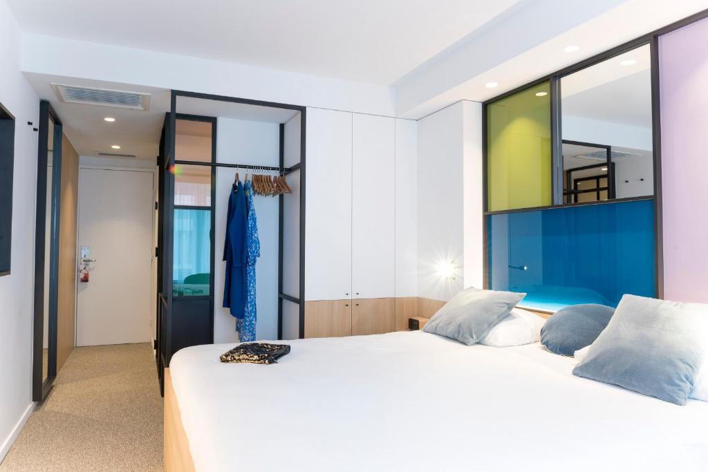 Un ou plusieurs lits dans un hébergement de l'établissement Hotel Nelson