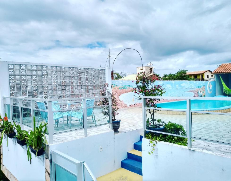 A view of the pool at Pousada Azul or nearby