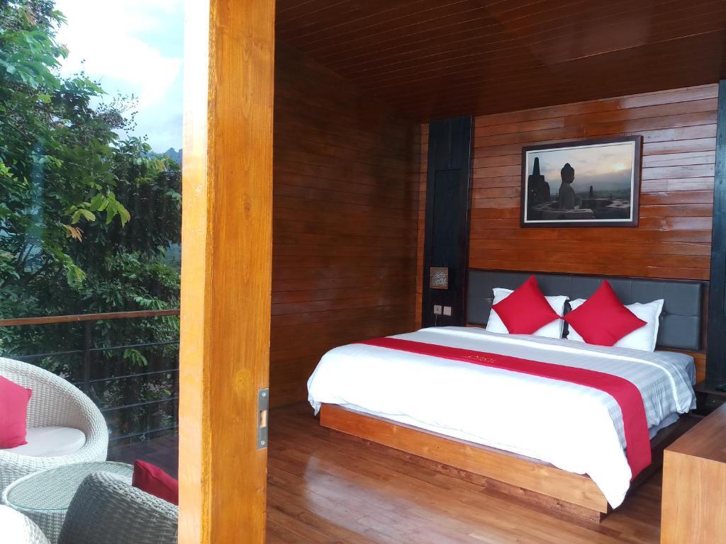 Un ou plusieurs lits dans un hébergement de l'établissement Manohara Resort
