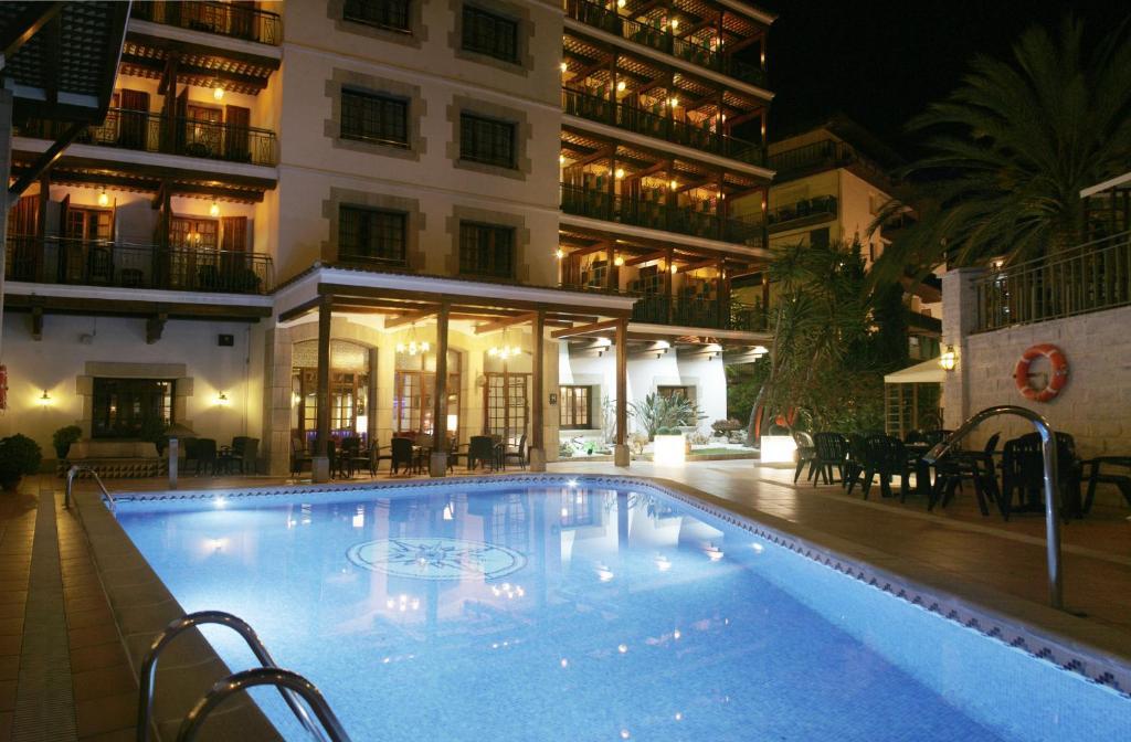 The swimming pool at or near Hotel La Carolina