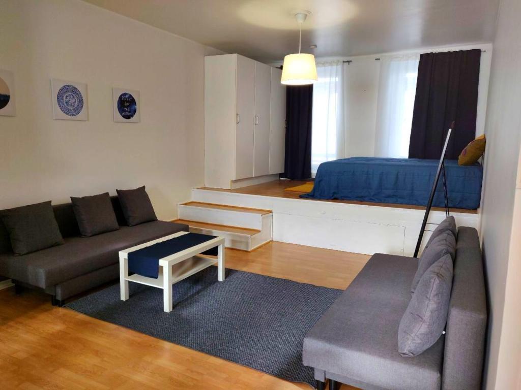 Posezení v ubytování Spacious 44m2 STUDIO apartment in Helsinki city center