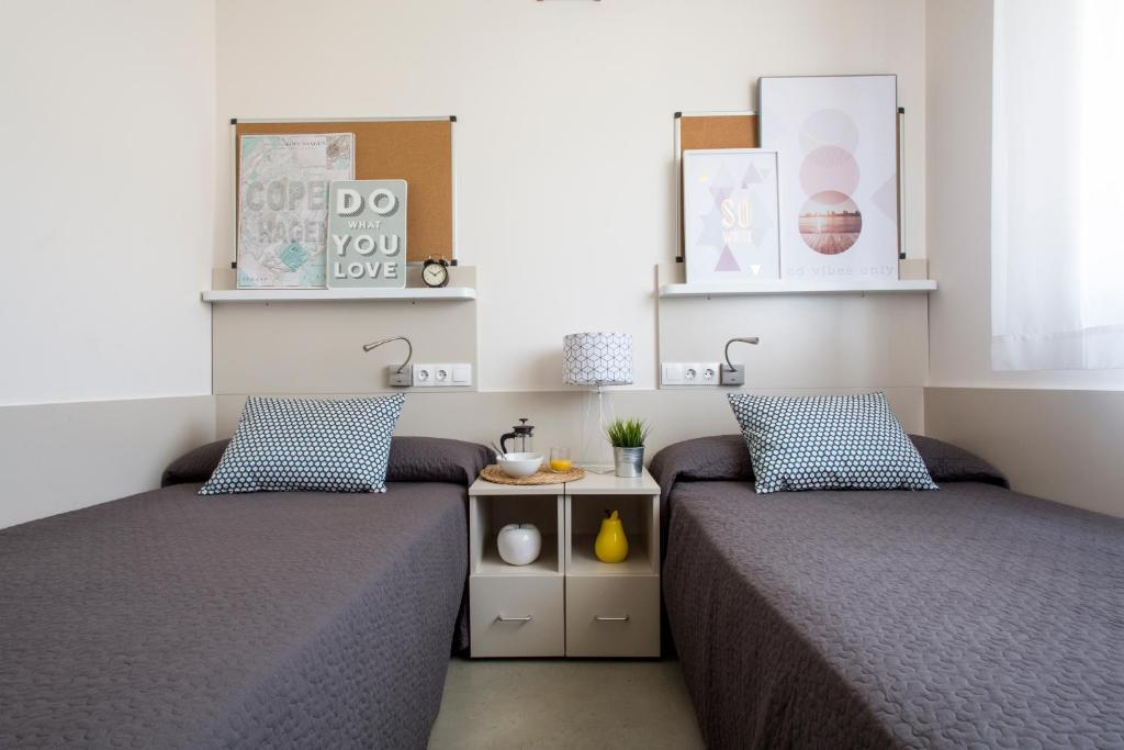 A bed or beds in a room at Residencia Universitaria La Salle