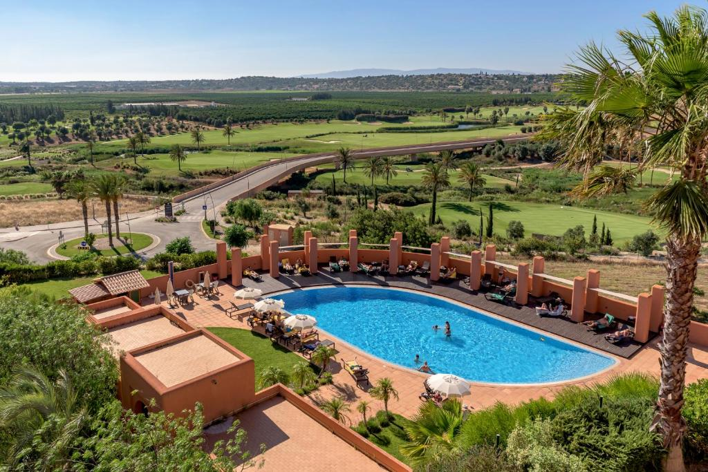 A view of the pool at Amendoeira Golf Resort or nearby