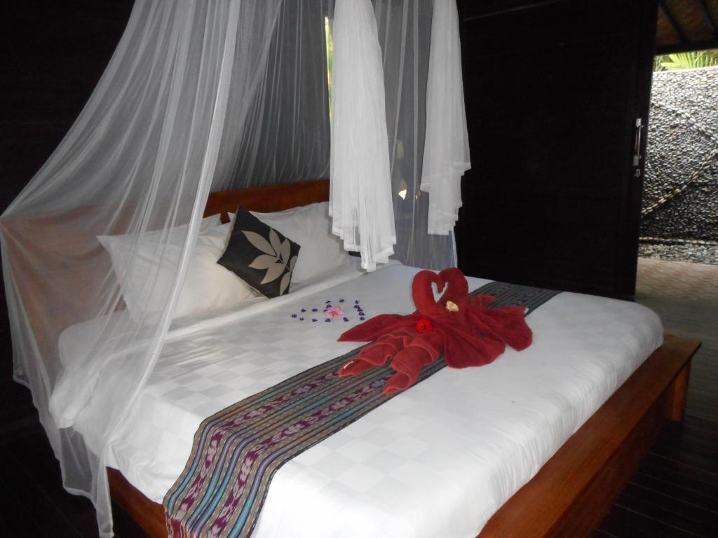 Vuode tai vuoteita majoituspaikassa Kubu Alas Tunggal Villa