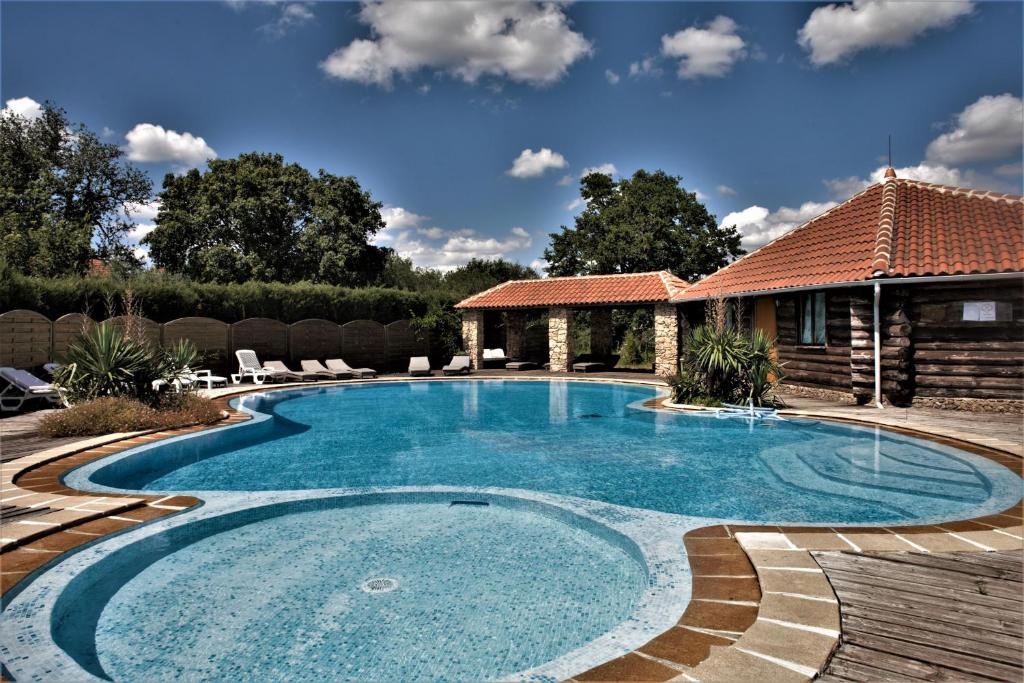 The swimming pool at or near Domaine de Vareilles