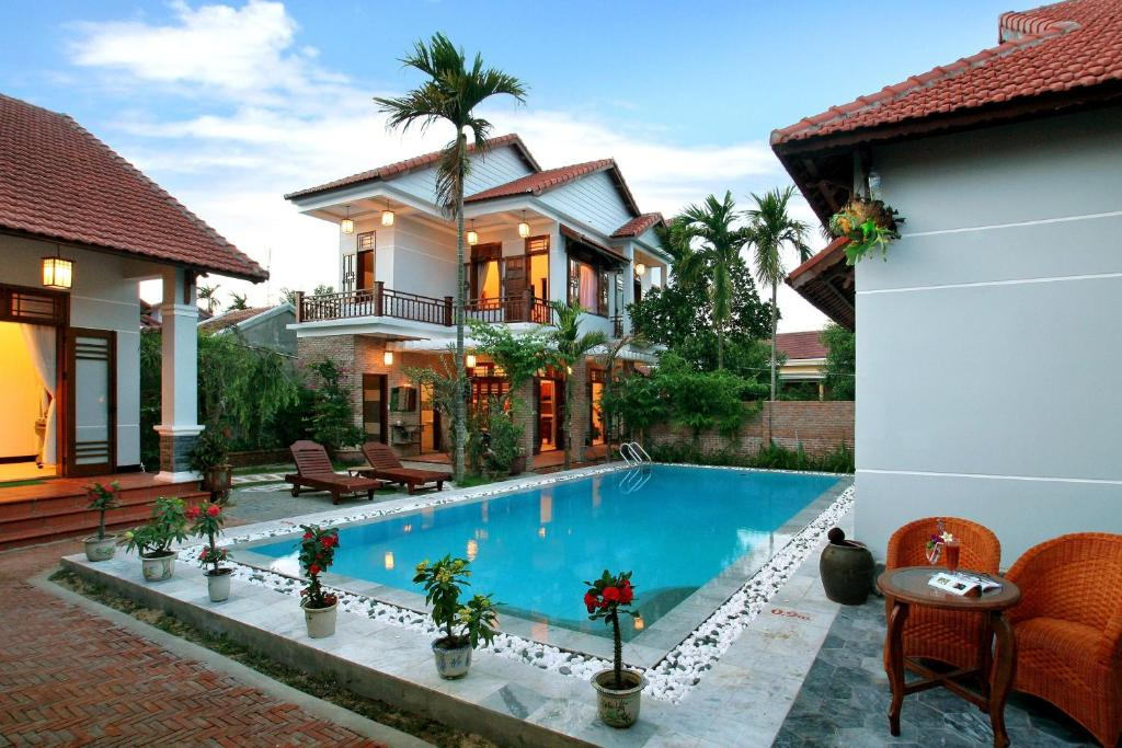 The swimming pool at or near The Hoi An Orchid Garden Villas