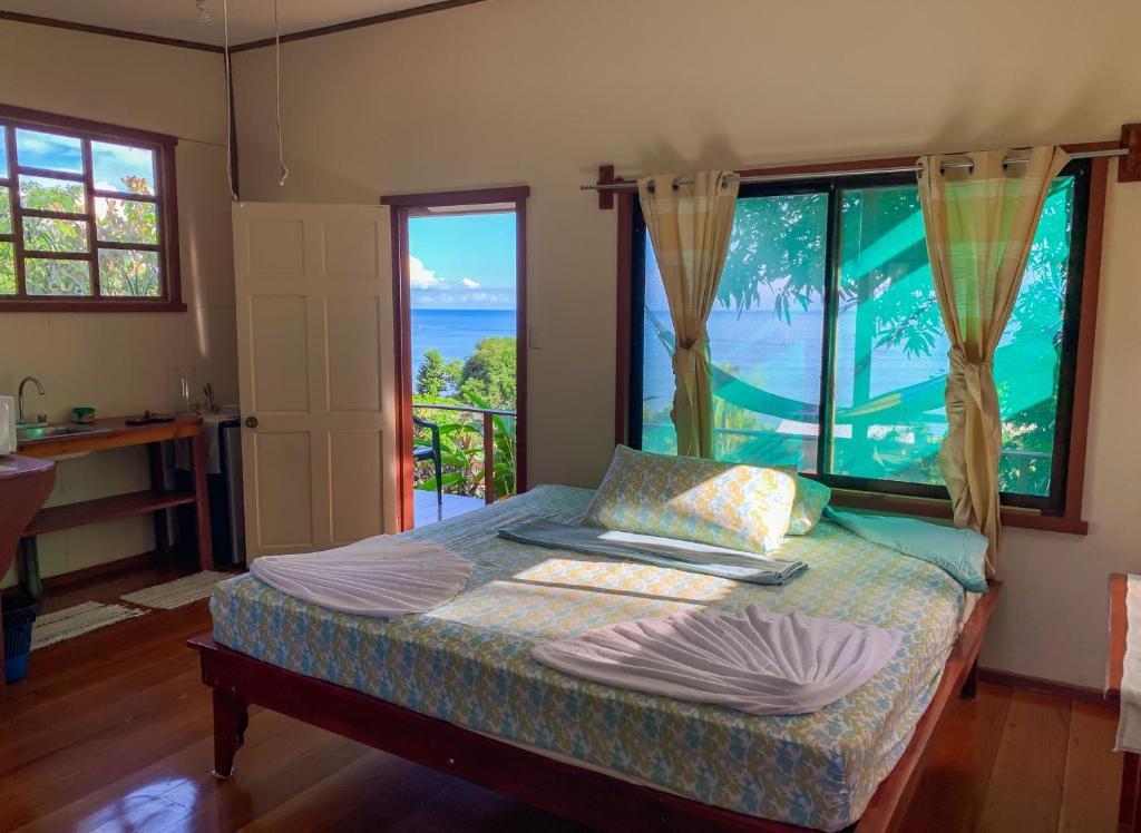 Cama o camas de una habitación en Jademar Cabins