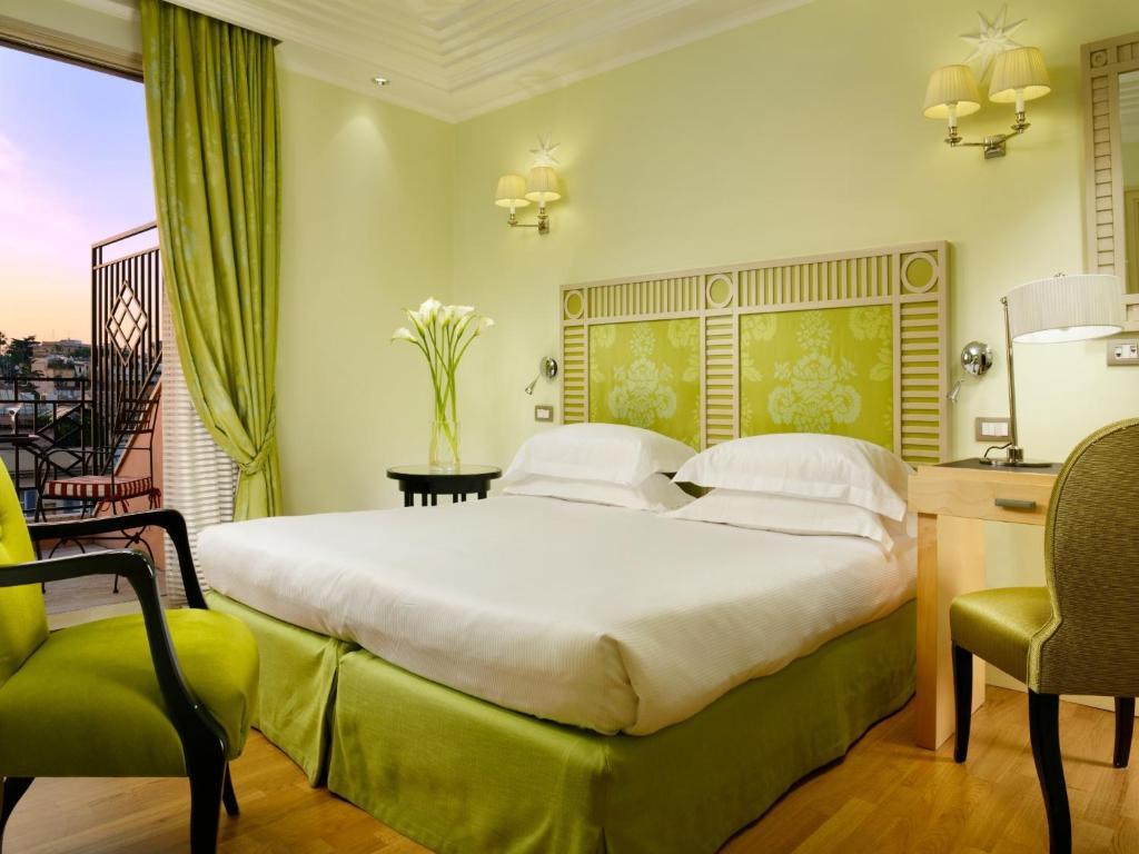 Uma cama ou camas num quarto em FH55 Grand Hotel Palatino