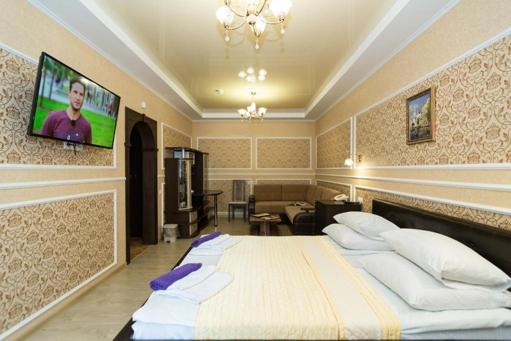 Кровать или кровати в номере Отель Joy