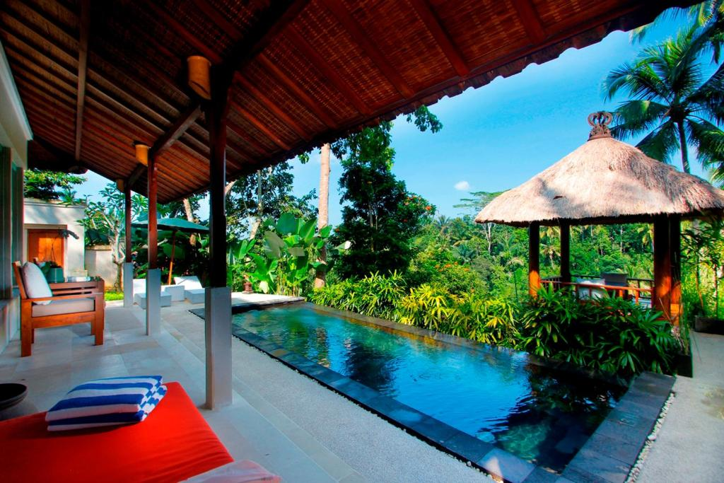 The swimming pool at or near Alam Ubud Culture Villa And Residence