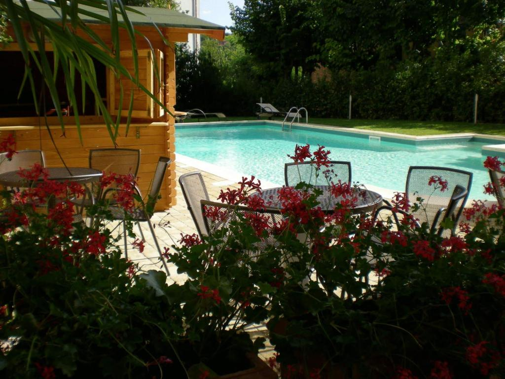 The swimming pool at or near Hotel Mizar